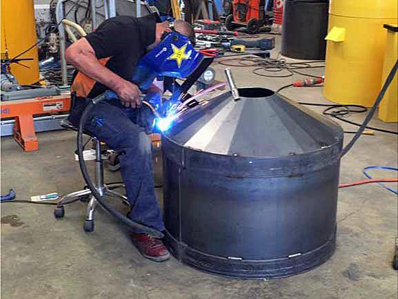 WAGS fabricator welding a single bowl
